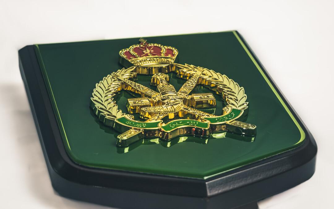 Diverse insignia designs include a recent crested desk shield